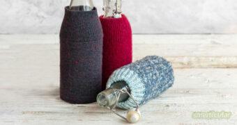 Für unterwegs: Eine alte Glasflasche mit einer Schutzhülle, die aus Filz oder selbst gehäkelt sein kann, ersetzt eine teure Trinkflasche.