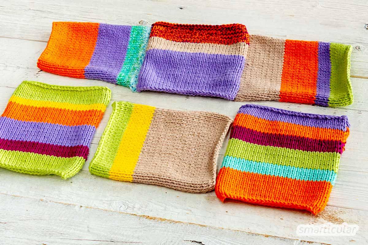 Eine Babydecke aus Wollresten ist schnell und einfach gestrickt: Einzelne Vierecke kannst du einfach im Patchwork-Muster nach und nach zusammennähen.