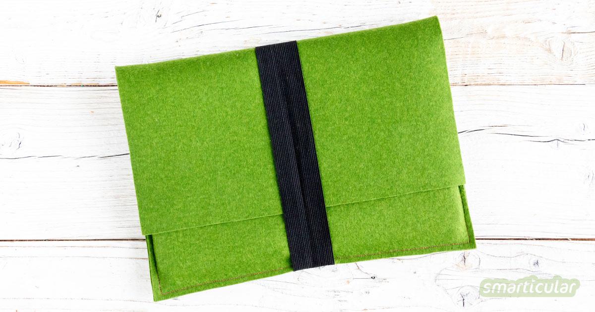 Eine Laptoptasche lässt sich aus Filz, zum Beispiel von einem eingelaufenen Pullover, ganz einfach selber nähen.